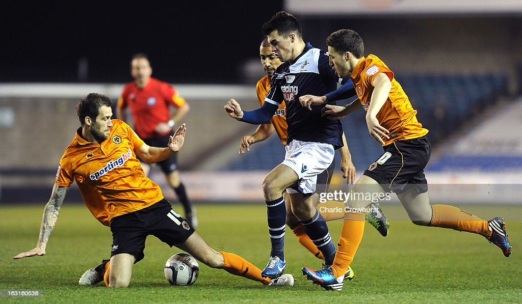 Roger Johnson of Wolves puts a tackle in on John Marquis of Millwall during the npower Championship match between Millwall and Wolverhampton Wanderers at The Den on March 05, 2013 in London, England,