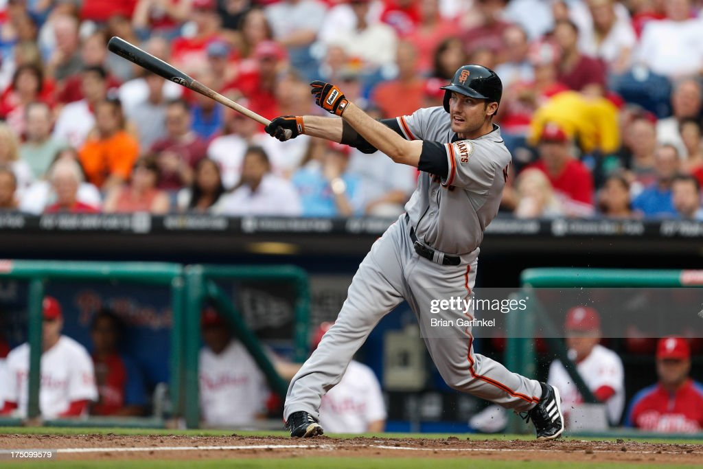 Roger Kieschnick #22 of the San Francisco Giants follows through on an RBI single in the first inning of the game against the Philadelphia Phillies at Citizens Bank Park on July 31, 2013 in Philadelphia, Pennsylvania.
