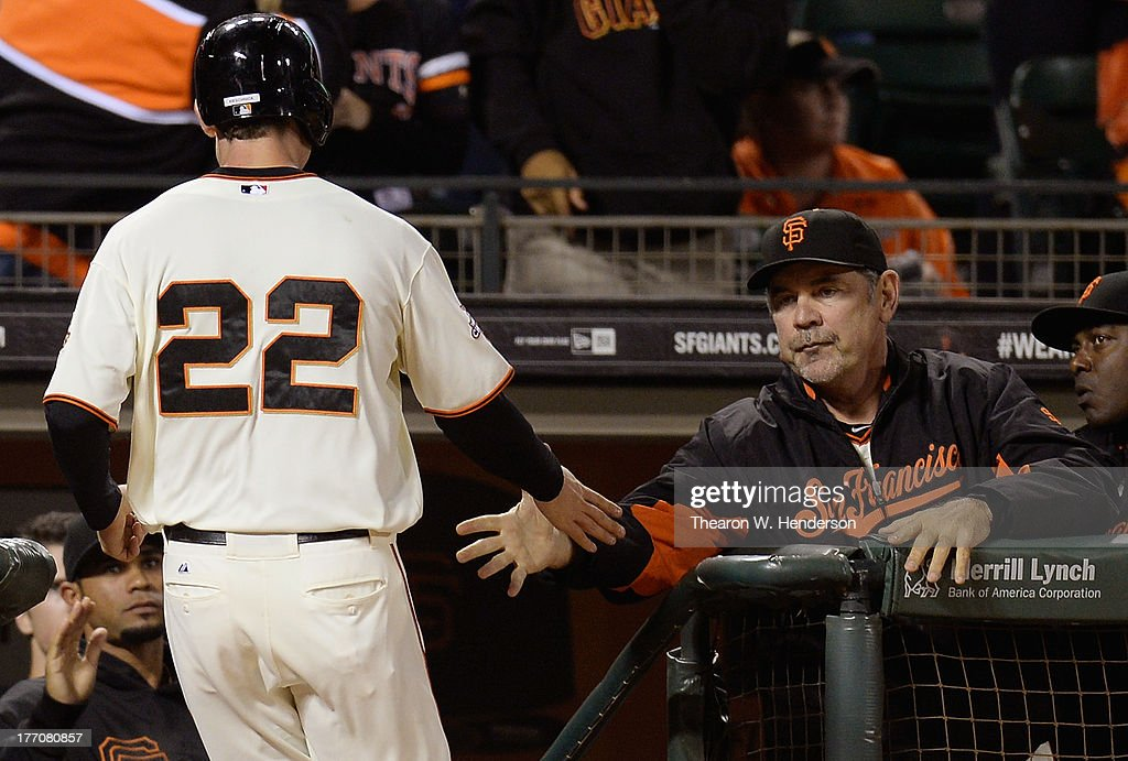 Roger Kieschnick #22 of the San Francisco Giants is congratulated by manager <a gi-track='captionPersonalityLinkClicked' href=/galleries/search?phrase=Bruce+Bochy&family=editorial&specificpeople=220291 ng-click='$event.stopPropagation()'>Bruce Bochy</a> #15 after Kieschnick scored on a Joaquin Arias RBI triple in the fifth inning against the Boston Red Sox at AT&T Park on August 20, 2013 in San Francisco, California.
