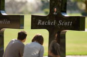 Roger Kovacs and his wife Lesli sit quietly in front of a memorial to Roger's friend Rachel Scott and other victims of the Columbine High School...