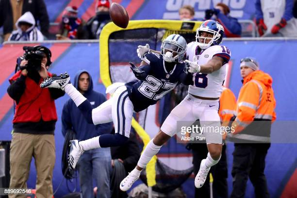 Roger Lewis of the New York Giants reaches for a pass against Jourdan Lewis of the Dallas Cowboys in the third quarter during their game at MetLife...