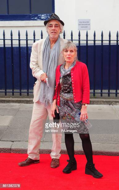 Roger Lloyd Pack and his wife Jehane Markham arriving at the opening night of Charlie and the Chocolate Factory at the Theatre Royal Drury Lane in...