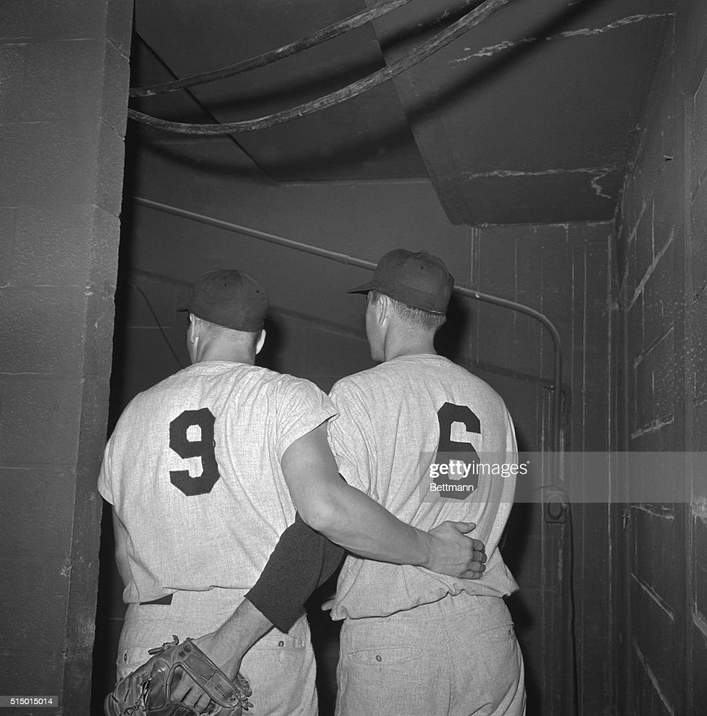 Roger Maris and Yankee teammate Clete Boyer head for the dressing room after defeating the Orioles 42 to win the American League pennant Roger did...