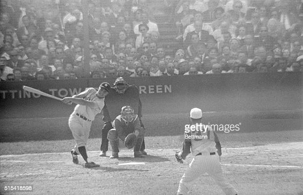 Roger Maris connects for a homerun in the 9th inning to give the Yankees a 3 to 2 victory over the Reds Reds pitcher Bob Purkey is shown delivering...
