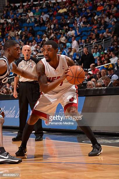 Roger Mason Jr #21 of the Miami Heat controls the ball against the Orlando Magic on January 4 2014 at Amway Center in Orlando Florida NOTE TO USER...