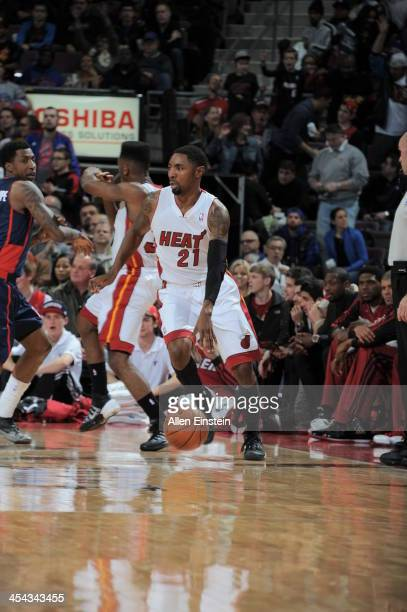 Roger Mason Jr #21 of the Miami Heat dribble up the court against the Detroit Pistons during the game on December 8 2013 at The Palace of Auburn...