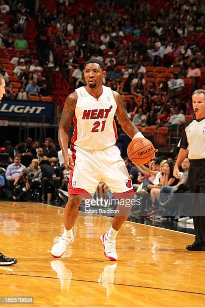Roger Mason Jr #21 of the Miami Heat dribbles the ball against the San Antonio Spurs during a game on October 19 2013 at American Airlines Arena in...