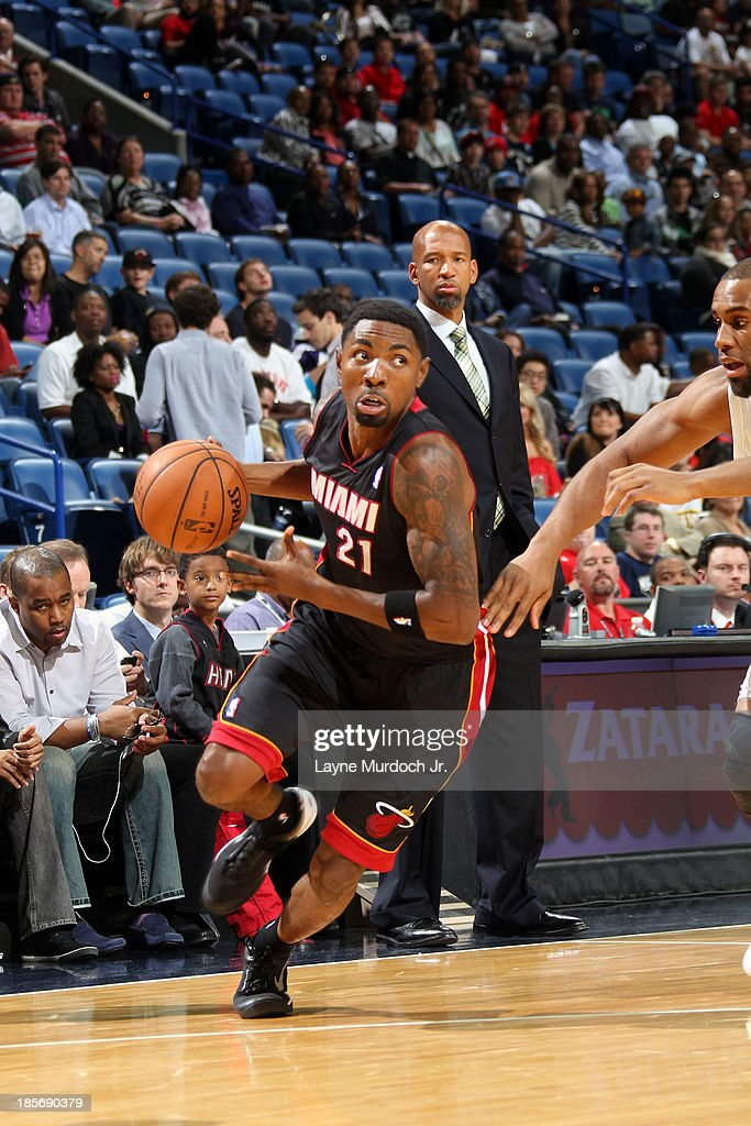 <a gi-track='captionPersonalityLinkClicked' href=/galleries/search?phrase=Roger+Mason+Jr.&family=editorial&specificpeople=220399 ng-click='$event.stopPropagation()'>Roger Mason Jr.</a> #21 of the Miami Heat dribbles up the floor against the New Orleans Pelicans during an NBA preseason game on October 23,2013 at the New Orleans Arena in New Orleans, Louisiana.