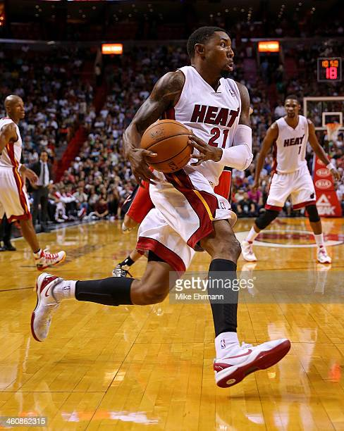 Roger Mason Jr #21 of the Miami Heat drives during a game against the Toronto Raptors at AmericanAirlines Arena on January 5 2014 in Miami Florida...