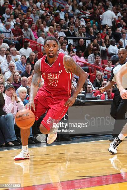 Roger Mason Jr #21 of the Miami Heat drives to the basket against the Phoenix Suns on November 25 2013 at American Airlines Arena in Miami Florida...
