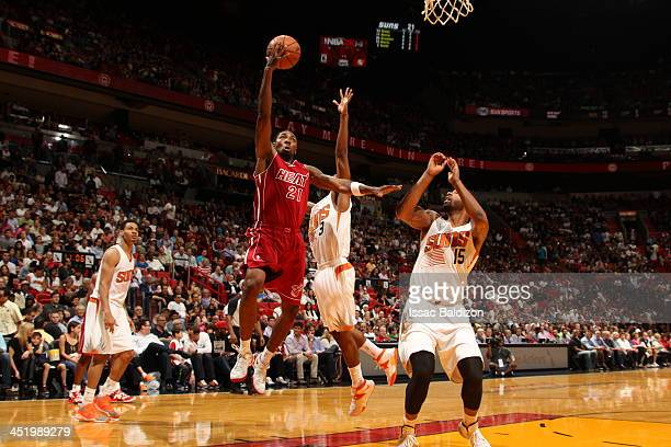 Roger Mason Jr #21 of the Miami Heat goes up for the layup against the Phoenix Suns on November 25 2013 at American Airlines Arena in Miami Florida...