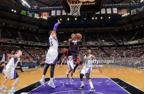 Roger Mason Jr #21 of the Miami Heat goes up for the shot against Derrick Williams of the Sacramento Kings on December 27 2013 at Sleep Train Arena...