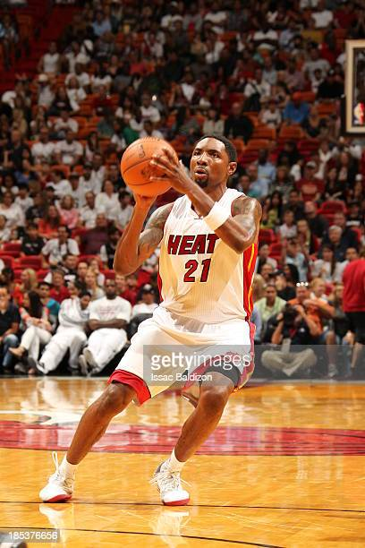 Roger Mason Jr #21 of the Miami Heat goes up for the shot against the San Antonio Spurs during a game on October 19 2013 at American Airlines Arena...
