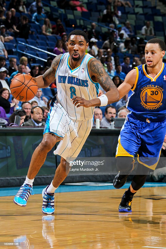 Roger Mason Jr. #8 of the New Orleans Hornets drives against Stephen Curry #30 of the Golden State Warriors on March 18, 2013 at the New Orleans Arena in New Orleans, Louisiana.