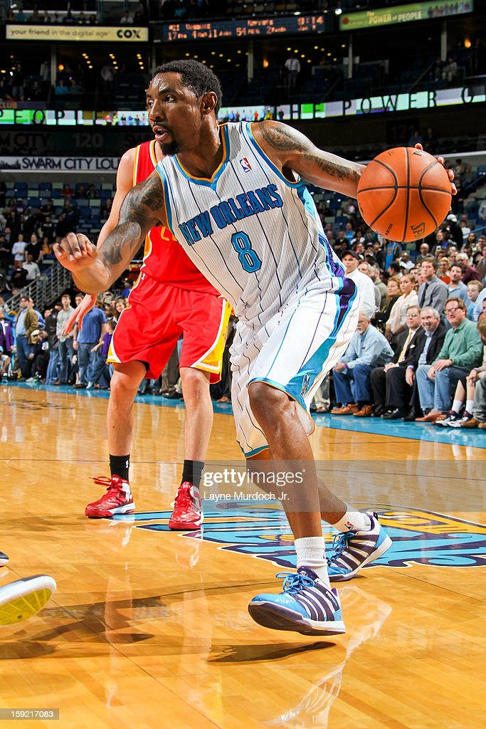 <a gi-track='captionPersonalityLinkClicked' href=/galleries/search?phrase=Roger+Mason+Jr.&family=editorial&specificpeople=220399 ng-click='$event.stopPropagation()'>Roger Mason Jr.</a> #8 of the New Orleans Hornets drives against the Houston Rockets on January 9, 2013 at the New Orleans Arena in New Orleans, Louisiana.