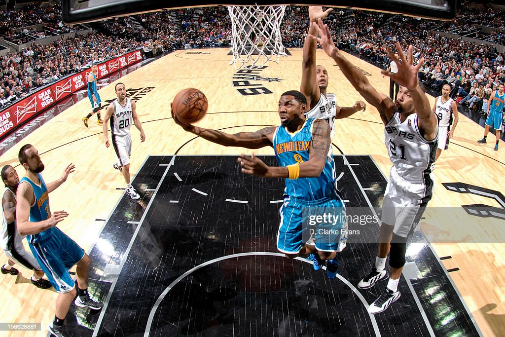 <a gi-track='captionPersonalityLinkClicked' href=/galleries/search?phrase=Roger+Mason+Jr.&family=editorial&specificpeople=220399 ng-click='$event.stopPropagation()'>Roger Mason Jr.</a> #8 of the New Orleans Hornets drives to the basket against <a gi-track='captionPersonalityLinkClicked' href=/galleries/search?phrase=Tim+Duncan&family=editorial&specificpeople=201467 ng-click='$event.stopPropagation()'>Tim Duncan</a> #21 and <a gi-track='captionPersonalityLinkClicked' href=/galleries/search?phrase=Boris+Diaw&family=editorial&specificpeople=201505 ng-click='$event.stopPropagation()'>Boris Diaw</a> #33 of the San Antonio Spurs on December 21, 2012 at the AT&T Center in San Antonio, Texas.