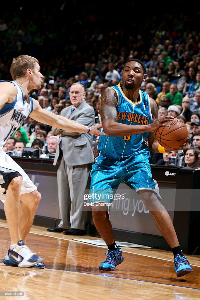 <a gi-track='captionPersonalityLinkClicked' href=/galleries/search?phrase=Roger+Mason+Jr.&family=editorial&specificpeople=220399 ng-click='$event.stopPropagation()'>Roger Mason Jr.</a> #8 of the New Orleans Hornets looks to pass the ball against <a gi-track='captionPersonalityLinkClicked' href=/galleries/search?phrase=Luke+Ridnour&family=editorial&specificpeople=201824 ng-click='$event.stopPropagation()'>Luke Ridnour</a> #13 of the Minnesota Timberwolves on March 17, 2013 at Target Center in Minneapolis, Minnesota.