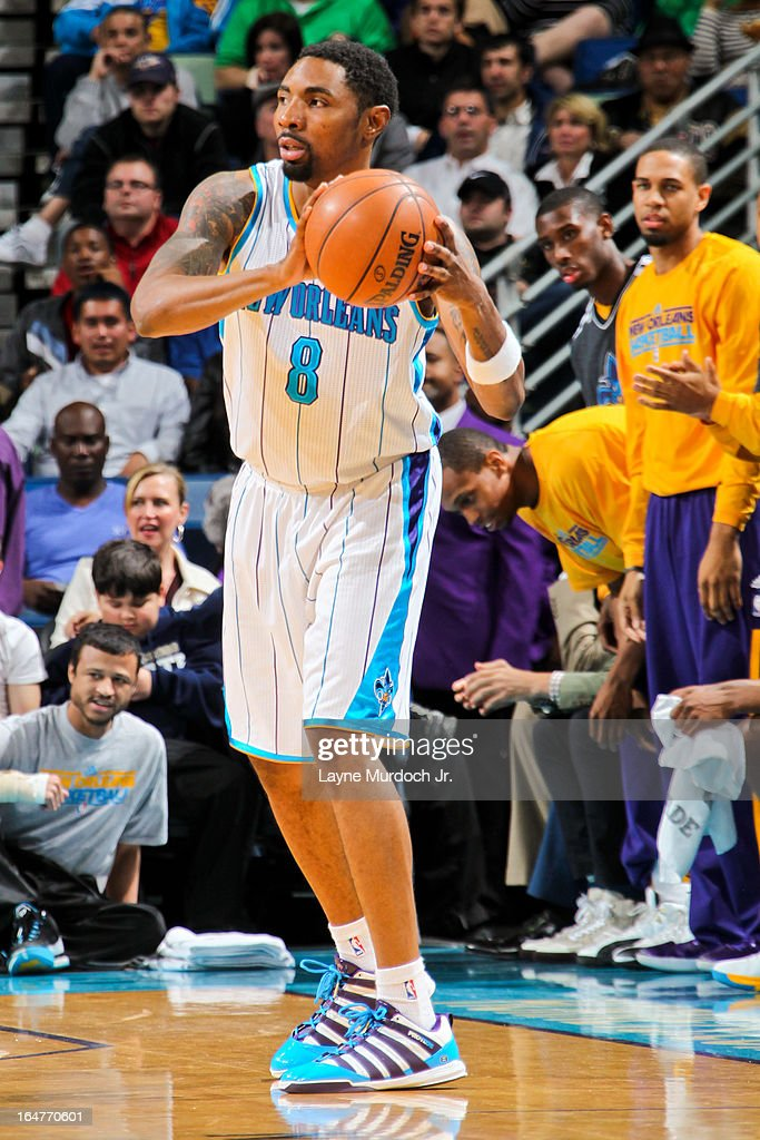 <a gi-track='captionPersonalityLinkClicked' href=/galleries/search?phrase=Roger+Mason+Jr.&family=editorial&specificpeople=220399 ng-click='$event.stopPropagation()'>Roger Mason Jr.</a> #8 of the New Orleans Hornets looks to pass the ball against the Denver Nuggets on March 25, 2013 at the New Orleans Arena in New Orleans, Louisiana.