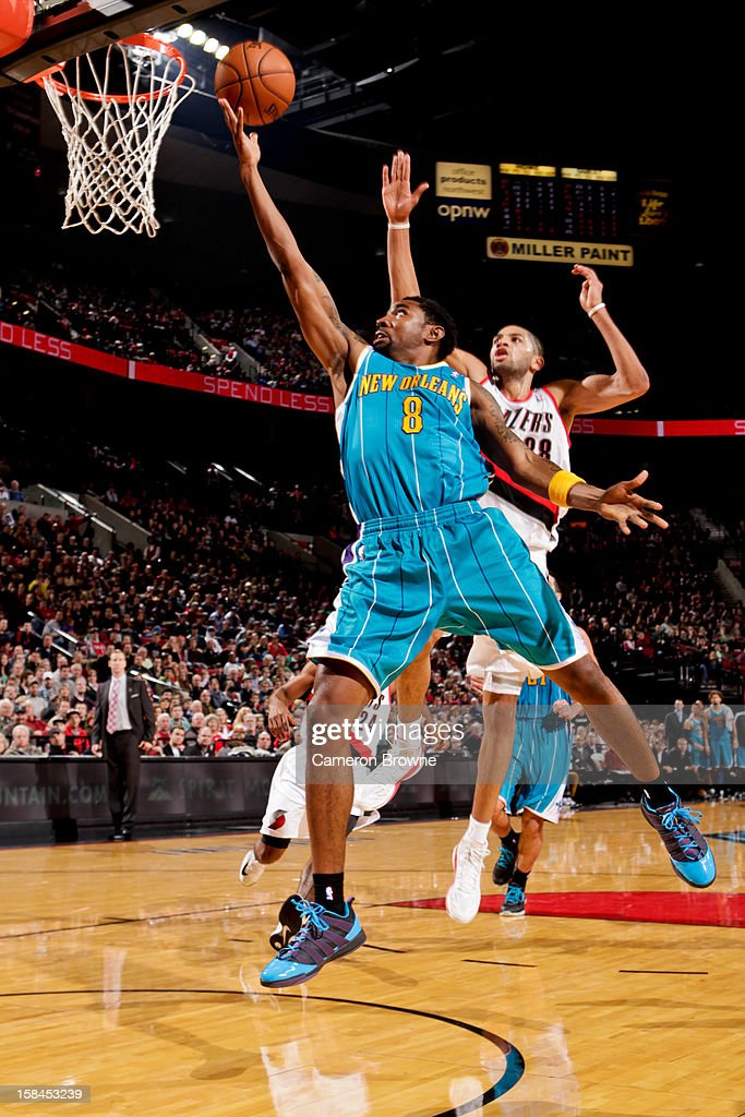 <a gi-track='captionPersonalityLinkClicked' href=/galleries/search?phrase=Roger+Mason+Jr.&family=editorial&specificpeople=220399 ng-click='$event.stopPropagation()'>Roger Mason Jr.</a> #8 of the New Orleans Hornets shoots a layup against <a gi-track='captionPersonalityLinkClicked' href=/galleries/search?phrase=Nicolas+Batum&family=editorial&specificpeople=3746275 ng-click='$event.stopPropagation()'>Nicolas Batum</a> #88 of the Portland Trail Blazers on December 16, 2012 at the Rose Garden Arena in Portland, Oregon.