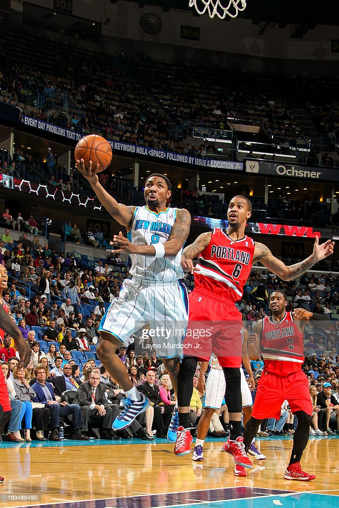 <a gi-track='captionPersonalityLinkClicked' href=/galleries/search?phrase=Roger+Mason+Jr.&family=editorial&specificpeople=220399 ng-click='$event.stopPropagation()'>Roger Mason Jr.</a> #8 of the New Orleans Hornets shoots a layup ahead of Eric Maynor #6 of the Portland Trail Blazers on March 10, 2013 at the New Orleans Arena in New Orleans, Louisiana.