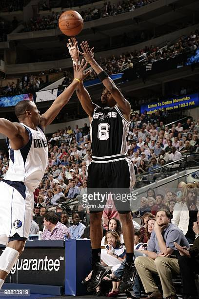 Roger Mason Jr #8 of the San Antonio Spurs shoots a jump shot against Caron Butler of the Dallas Mavericks during the game at American Airlines...