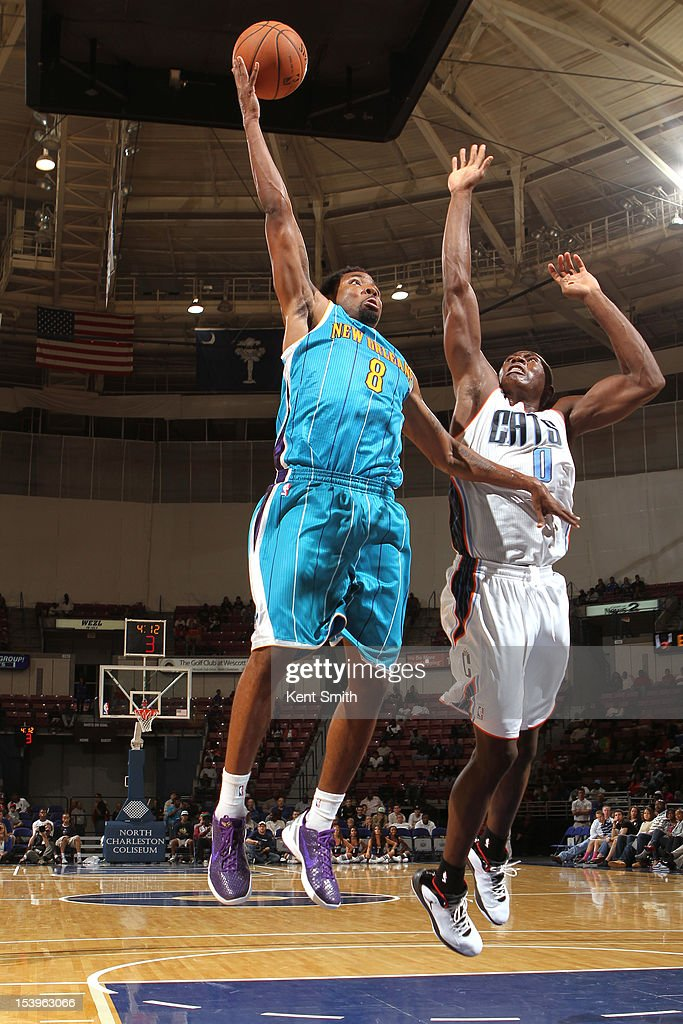 Roger Mason #8 of the New Orleans Hornets drives against <a gi-track='captionPersonalityLinkClicked' href=/galleries/search?phrase=Bismack+Biyombo&family=editorial&specificpeople=7640443 ng-click='$event.stopPropagation()'>Bismack Biyombo</a> #0 of the Charlotte Bobcats at the North Charleston Coliseum on October 11, 2012 in North Charleston, South Carolina.