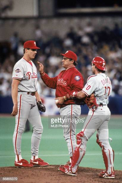 Roger Mason of the Philadelphia Phillies stands on the mound with manager Jim Fregosi and catcher Darren Daulton during game two of the 1993 World...