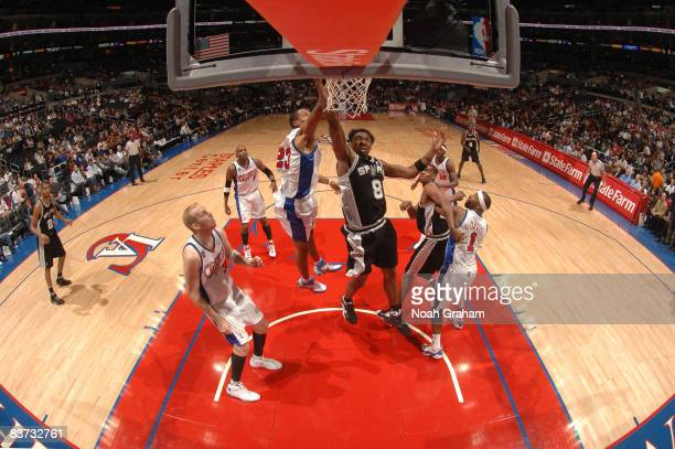 Roger Mason of the San Antonio Spurs puts up a shot against the Los Angeles Clippers at Staples Center on November 17 2008 in Los Angeles California...