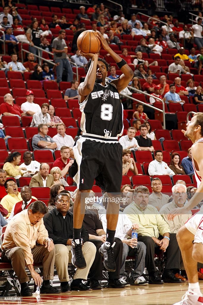 Roger Mason #8 of the San Antonio Spurs shoots a jump shot during the game against the Houston Rockets at the Toyota Center on October 9, 2008 in Houston, Texas. The Rockets won 85-78.