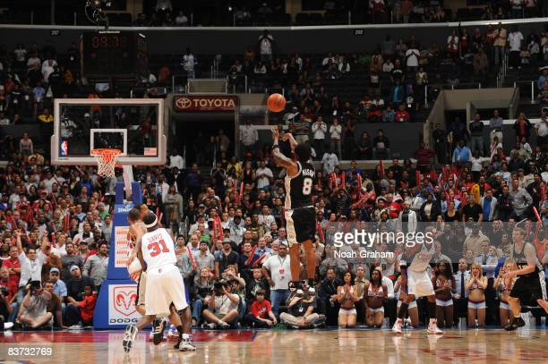 Roger Mason of the San Antonio Spurs shoots the goahead jumper to put the Spurs ahead of the Los Angeles Clippers 8683 during the fourth quarter of...