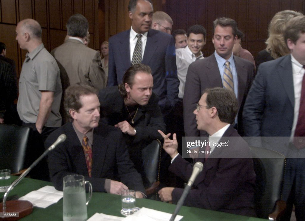 Roger McGuinn, a member of The Byrds, seated left, Lars Ulrich of Metallica center, Hank Barry CEO Napster seated right, share words before the Senate Judiciary Committee July11, 2000, in Washington, DC where they testified on musical copyright and the Internet. The Judiciary Committee is studying the future of digital music. Metallica is suing Napster for copyright infringement.