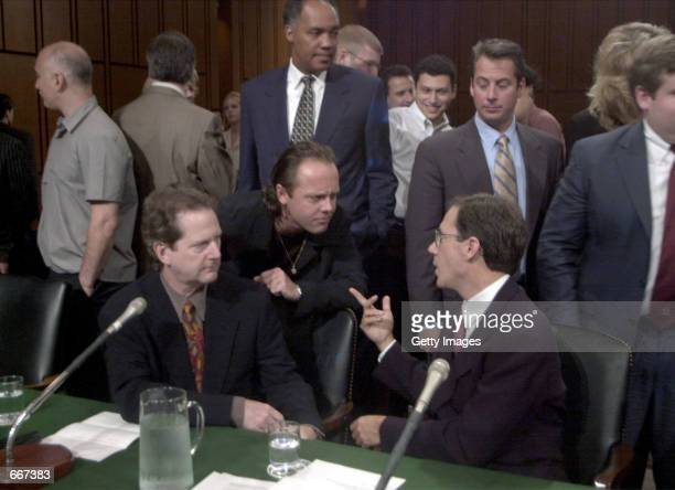 Roger McGuinn a member of The Byrds seated left Lars Ulrich of Metallica center Hank Barry CEO Napster seated right share words before the Senate...