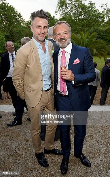 Roger Mele and Graham Norton attend The Bell Pottinger Summer Party at Lancaster House on June 7 2016 in London England