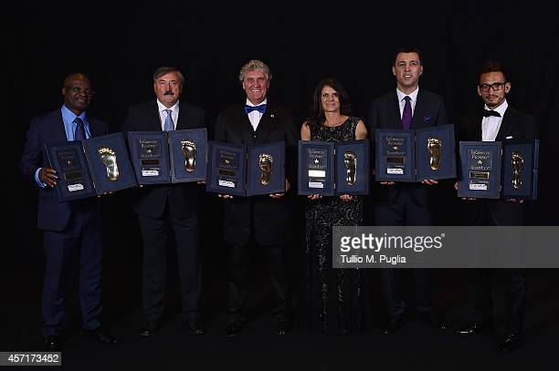 Roger Milla Antonin Panelka JeanMarie Pfaff Mia Hamm Hakan Sukur and Hidetoshi Nakata pose with Golden Foot awards during the Golden Foot 2014 Awards...
