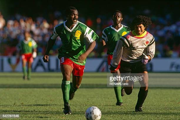 Roger Milla chases after Rene Higuita on his way to score a goal and put his team through to the quarterfinals of the 1990 FIFA World Cup