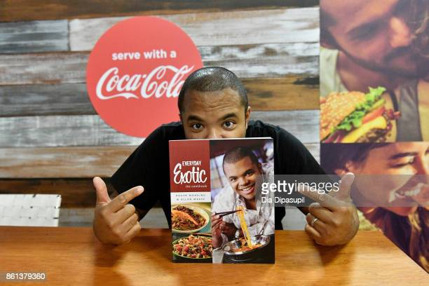 Roger Mooking signs his cookbook Everyday Exotic at the Food Network Cooking Channel New York City Wine Food Festival presented by CocaCola grand...