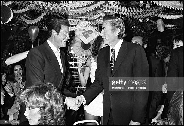 Roger Moore and Gregory Peck at Regine's night club in New York for Valentine's Day in 1982