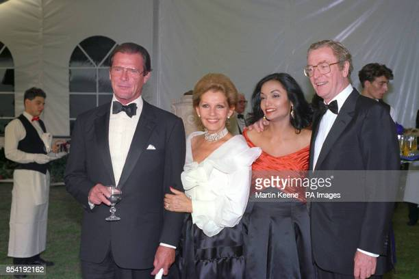 Roger Moore and his wife Luisa and Michael Caine and his wife Shakira in the grounds of Windsor Castle They were taking part in a charity gala...