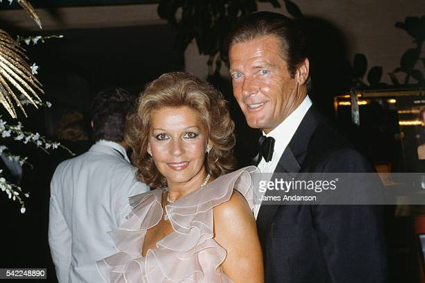 Roger Moore and his wife Luisa Mattioli attending the Monaco Red Cross Ball