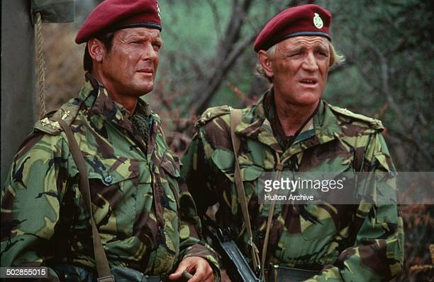 Roger Moore and Richard Harris looks on in a scene from the movie 'The Wild Geese' circa 1978