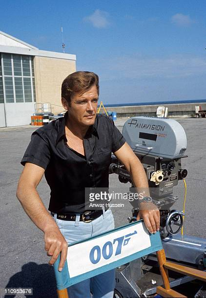 Roger Moore poses on location for the filming of James Bond film 'Live And Let Die' on March 1 1973 in Kingston Jamaica
