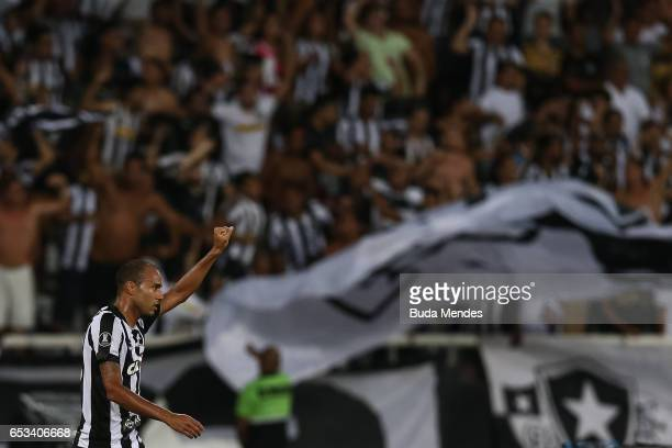 Roger of Botafogo celebrates a scored goal against Estudiantes during a match between Botafogo and Estudiantes as part of Copa Bridgestone...