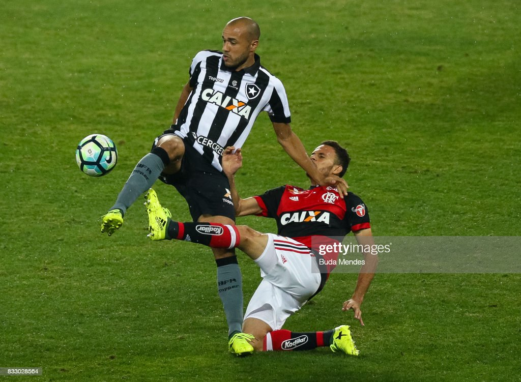 Roger (L) of Botafogo struggles for the ball with Gustavo Cullar of Flamengo during a match between Botafogo and Flamengo as part of Copa do Brasil Semifinals 2017 at Nilton Santos Olympic Stadium on August 16, 2017 in Rio de Janeiro, Brazil.