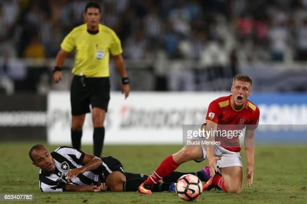 Roger of Botafogo struggles for the ball with Santiago Ascacibar of Estudiantes during a match between Botafogo and Estudiantes as part of Copa...