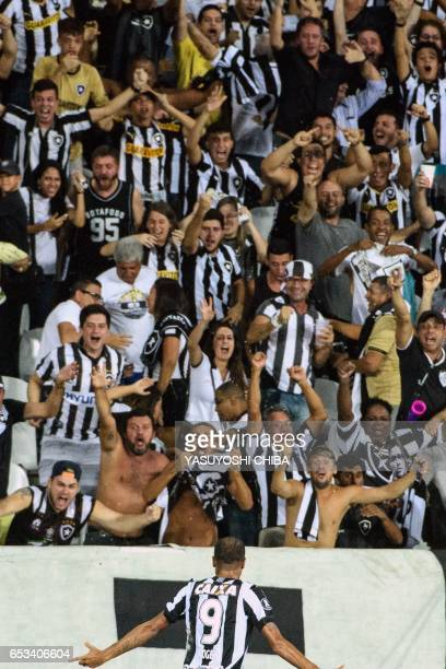 Roger of Brazil's Botafogo celebrates with supporters after scoring against Argentinas Estudiantes de La Plata during their Copa Libertadores 2017...
