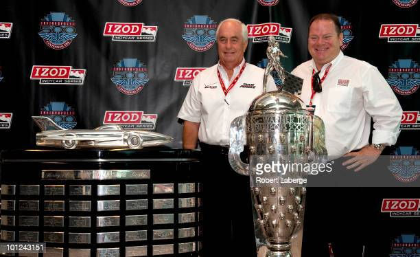 Roger Penske owner of Team Penkse and Chip Ganassi owner of Target Chip Ganassi Racing Team pose next to the Harley J Hearl Daytona 500 Trophy and...