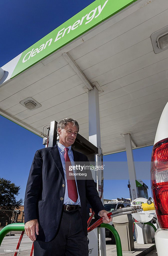 Roger Plank, co-president and chief corporate officer of Apache Corp., fills the tank of his 2011 Chevrolet Suburban sport utility vehicle (SUV), with compressed natural gas (CNG) at a fueling station in Houston, Texas, on Monday, Dec. 17, 2012. Apache Corp. is a gas exploration and production company with operations around the world, including the U.S., U.K., Canada and Argentina. Photographer: Craig Hartley/Bloomberg via Getty Images