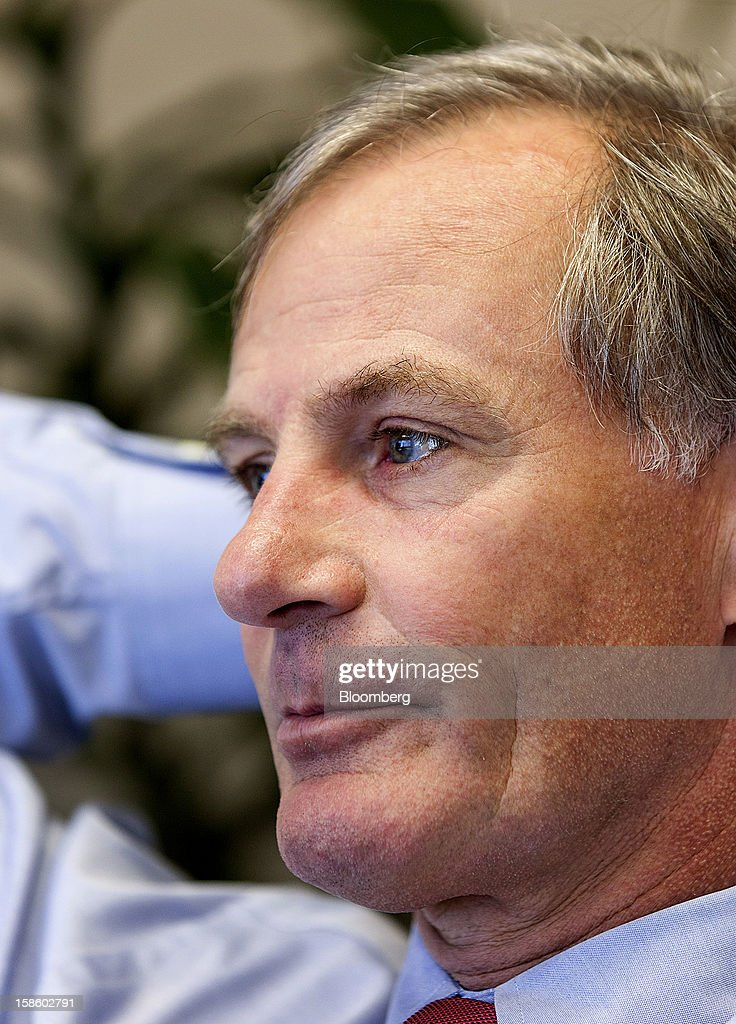 Roger Plank, co-president and chief corporate officer of Apache Corp., listens during interview at his office in Houston, Texas, on Monday, Dec. 17, 2012. Apache Corp. is a gas exploration and production company with operations around the world, including the U.S., U.K., Canada and Argentina. Photographer: Craig Hartley/Bloomberg via Getty Images