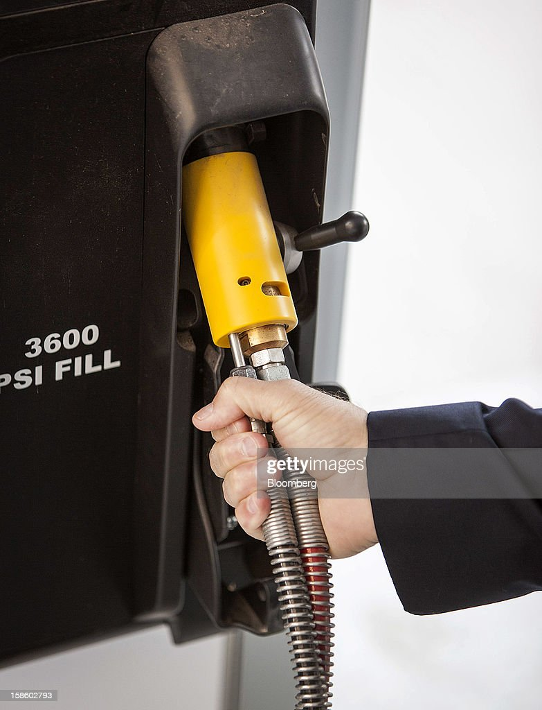 Roger Plank, co-president and chief corporate officer of Apache Corp., reaches for the pump at a compressed natural gas (CNG) fueling station in Houston, Texas, on Monday, Dec. 17, 2012. Apache Corp. is a gas exploration and production company with operations around the world, including the U.S., U.K., Canada and Argentina. Photographer: Craig Hartley/Bloomberg via Getty Images