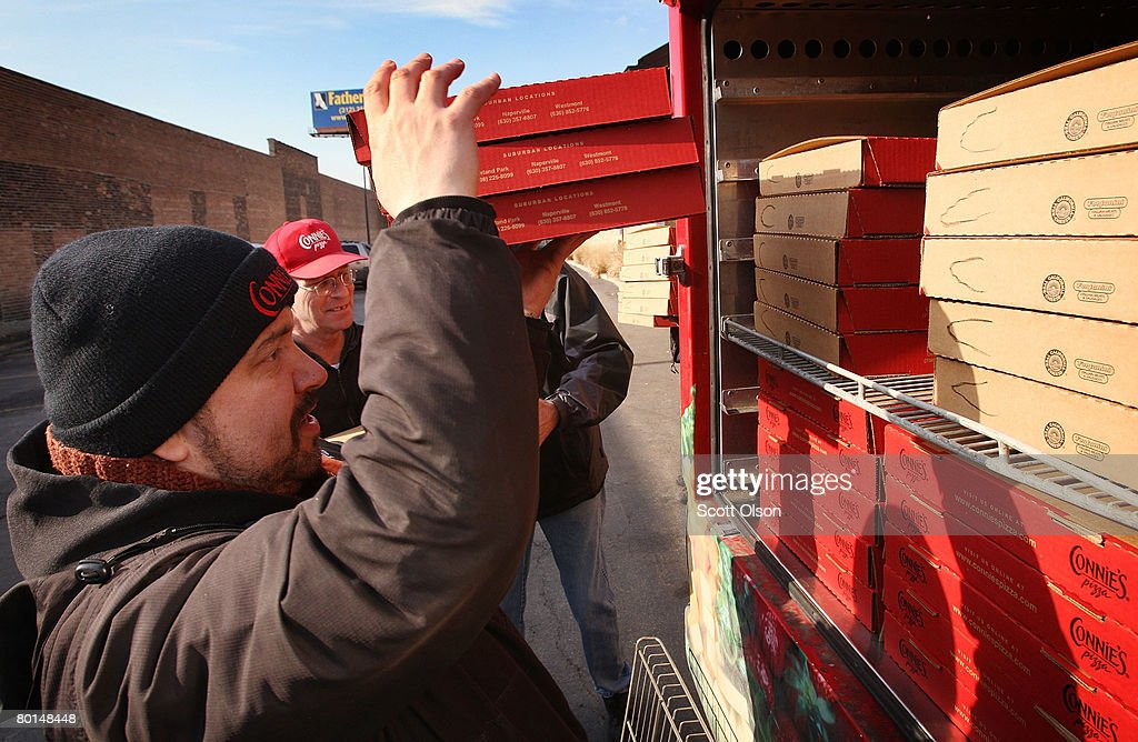 Roger Sansone loads pizzas for delivery into a heated truck at Connie's Pizza on March 6, 2008 in Chicago, Illinois. The cost of flour, a key ingredient in making pizza dough, has more than doubled in the past year because of high wheat prices caused by strong worldwide demand and increased price speculation. Connie's Pizza makes between 10 to 20 thousand pizzas each week.
